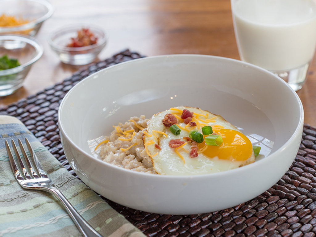 Porridge topped with egg and spring onions.