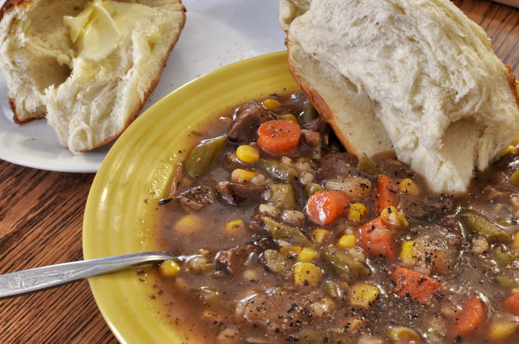 Beef and barley soup with fresh bread,